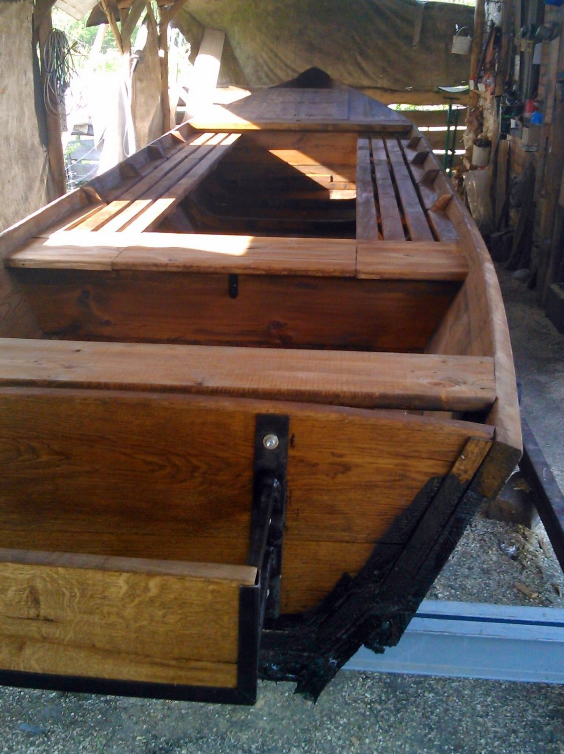 Wooden boat treated with dark tar oil