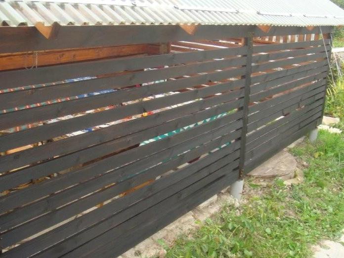 Dark tar oil for wood